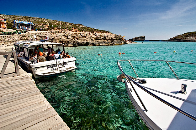 The small dock on Comino sees a stead stream of boat traiffic throughout the day