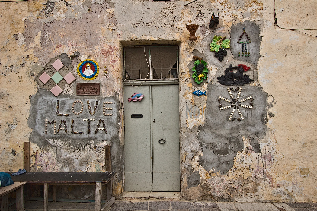 Maltese Cross on a house in the fishing village of Marsaxlokk