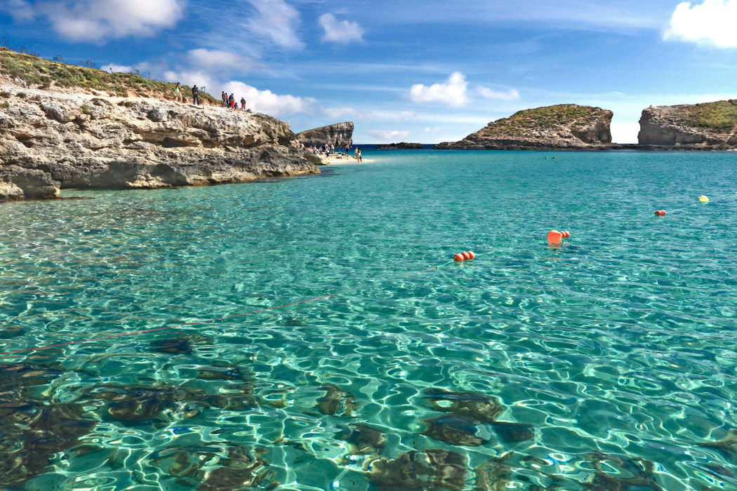 Buoys mark the point boats cannot cross, beyond which lies the famous Blue Hole of Comino in the Maltese Islands