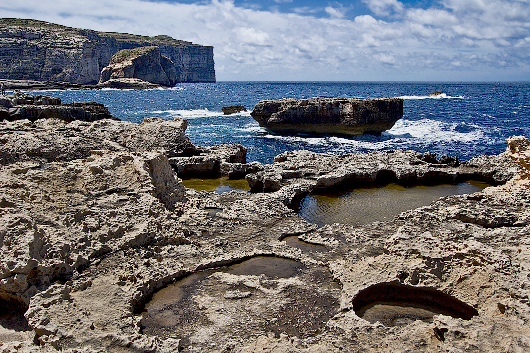 Fungus Rock on the far side of this bay on Gozo Island in Malta was prized for a fungus used for wounds and medicinal purposesMaltese-Islands-Gozo-Fungus-Rock-and-Crocodile-Rock