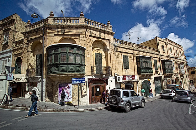 Beautiful old buildings with wooden balconies in Victoria, Gozo