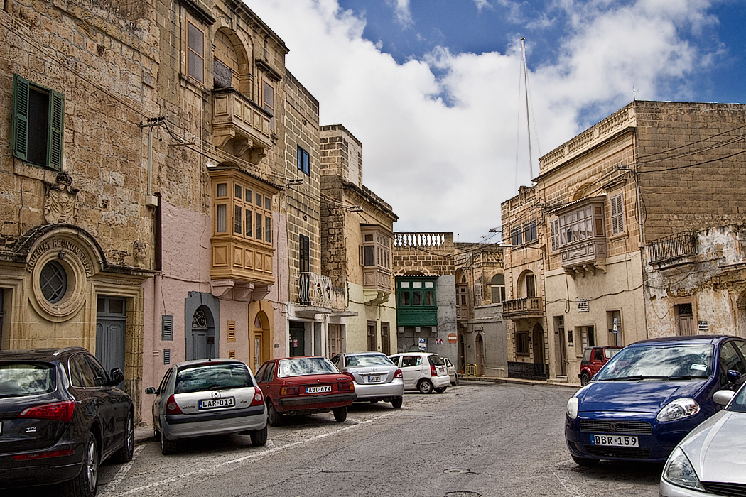 Gorgeous old limestone buildings in the capital city of Victoria, on the island of Gozo in the Maltese Islands