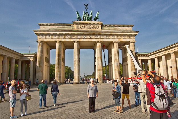 Standing in front of the Brandenburg Gate, which sat in the no-man's land between the two sides of the Berlin Wall during the Cold War