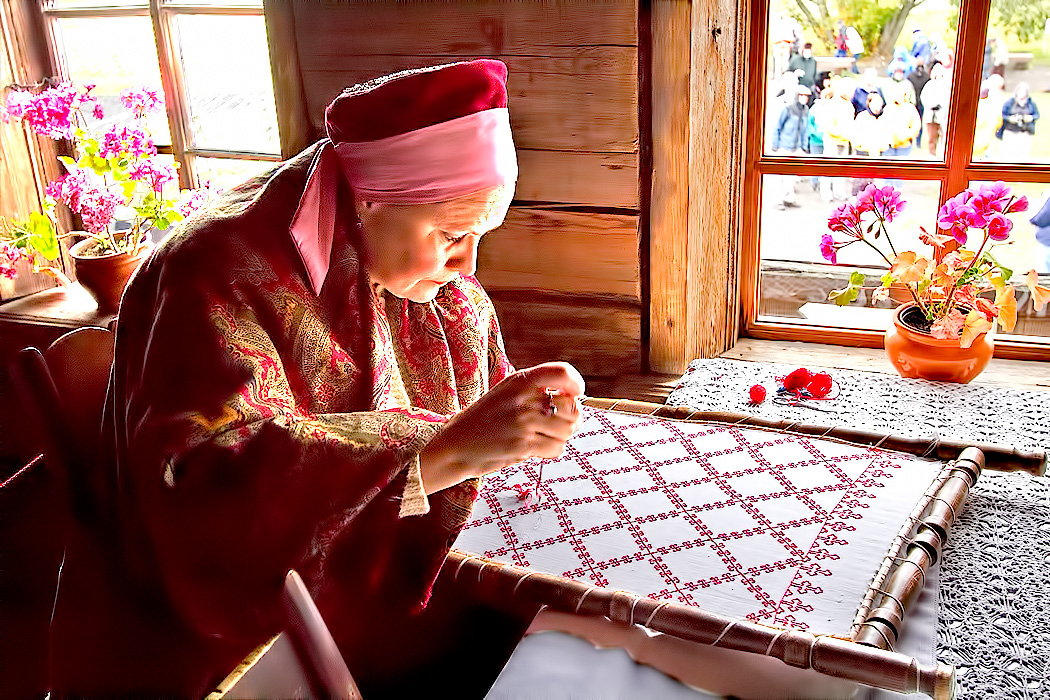 Woman creates traditional embroidered linens on Kizhi Island, Lake Onega, Russia
