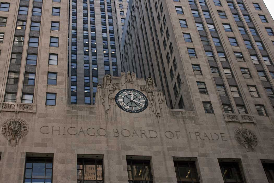 Art deco exterior of the Chicago Board of Trade Building in downtown Chicago features figures holding sheaves of wheat and stalks of corn, in homage to the commodities trading that still occurs here every business day