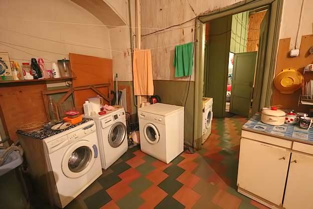 Washing machines for individual apartments stand in the common areas