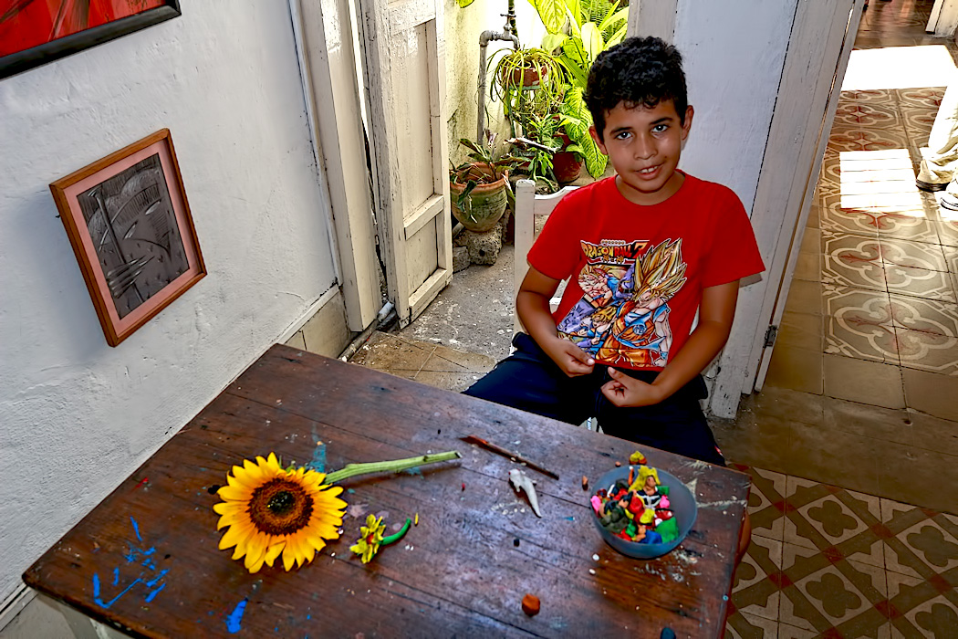 Young boy sculpts Play-Doh art at Trazos Libres community art project in Cienfuegos, Cuba