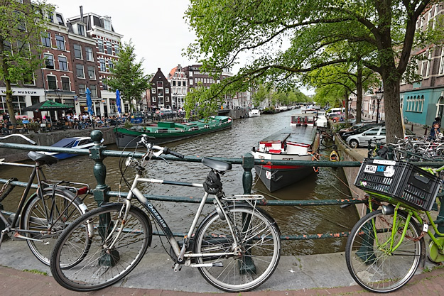 Another canal, another collection of parked bicycles in Amsterdam, Netherlands