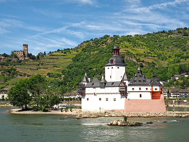 Pfalzgrafenstein Castle is one of two in the Middle Rhine Valley that was built on an island rather than a hilltop. At the top left, Gutenfels castle takes the high ground