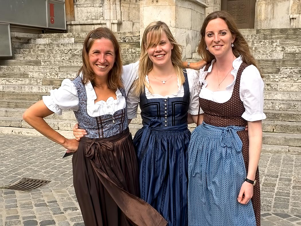 Women in Regensburg, Germany don traditional Bavarian outfits to celebrate the installation of the new Auxilliary Bishop