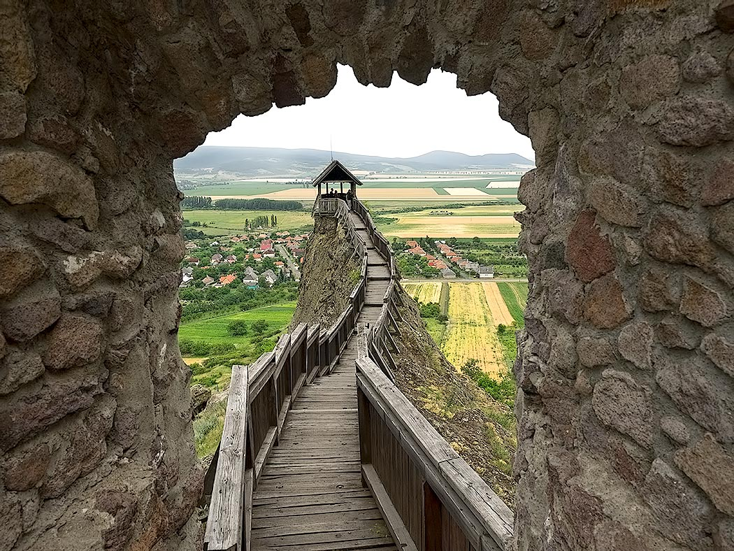 Precarious walkway in northern Hungary leads to the head of Lion's Rock at Boldogko Castle, used as a watchtower for centuries during medieval times