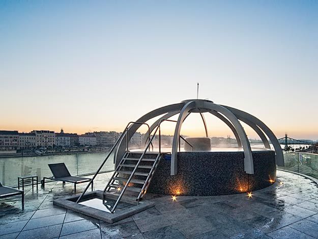 Rooftop pool at Rudas Baths overlooks the Danube and Pest side of Budapest