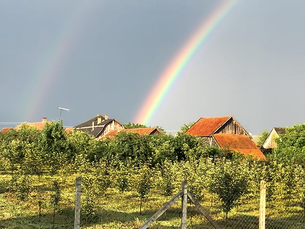 A double rainbow appears over Panyola, Hungary. Does it lead to a pot of gold, or will the policies of the European Union impede their progress?