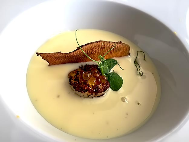 Braised scallop over mango, drenched with cold Vichyssoise at Borkonyha Restaurant