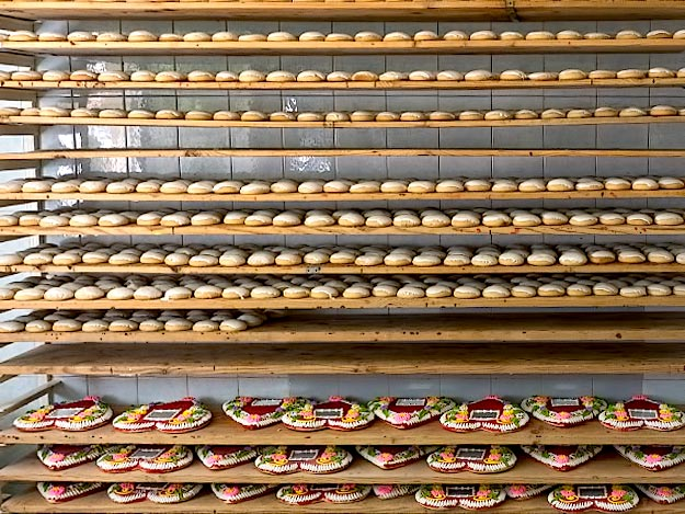 Traditional Hungarian Honey Cakes await packaging in the Debrecen workshop of Laszlo Radics. The ones on the top shelf are soft and chewy. The heart shaped ones on the bottom are hard, as they are meant to give as gifts that last, and are not meant to be eaten.