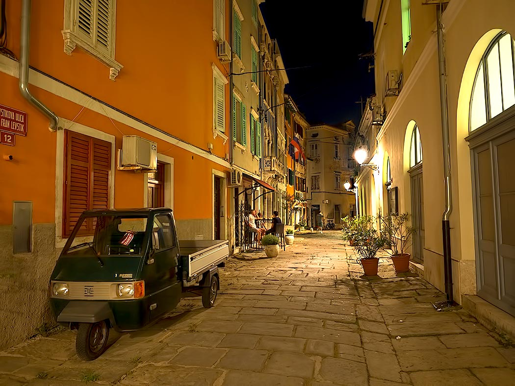 Cobblestone streets of Piran, Slovenia by night