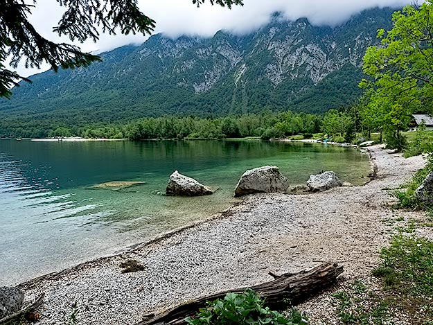 Karst mountains frame the gorgeous emerald-colored waters of Lake Bohinj
