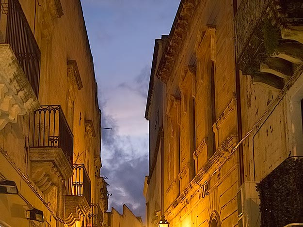 Buildings in the historic center of Gallipoli, awash with golden light