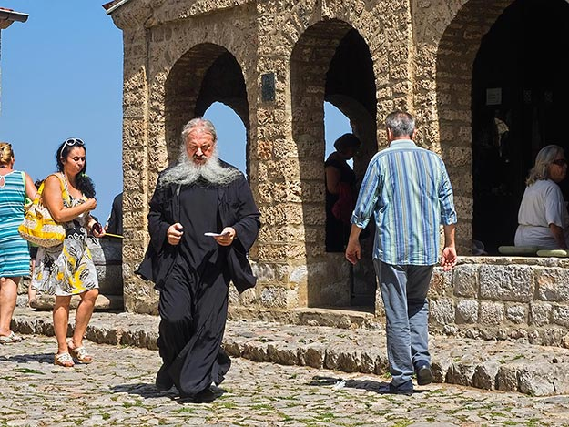 Priest leaves St. Naum Monastery after officiating at a wedding