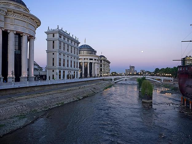 Neo-classic Roman government buildings on Dimitar Vlahov Walk along the Vardar River in Skopje