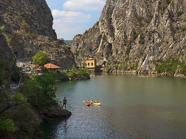 Lake Matka, behind the dam that created the world's first man-made lake. Kayaking is a popular activity in Matka Canyon