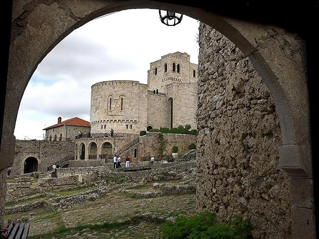 National Skanderbeg Museum, viewed through an archway within the ruins of Kruje Castle