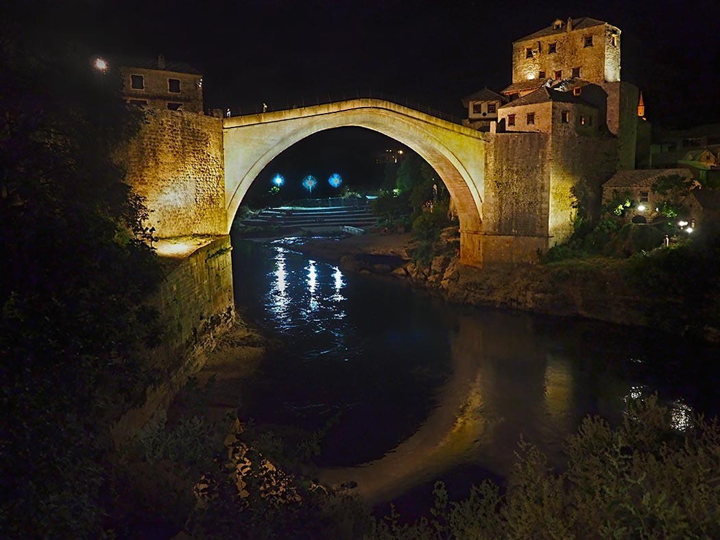 "Stari Most, literally ""Old Bridge"" in Bosnian. This ancient stone bridge was shelled to bits during the Bosnian War, but rebuilt to its original form after hostilities ceased."