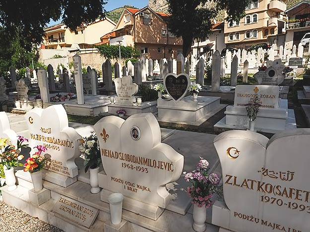 Rows of gravestones in the center of town are dated 1993, a painful memory of the thousands who died during the Bosnian War