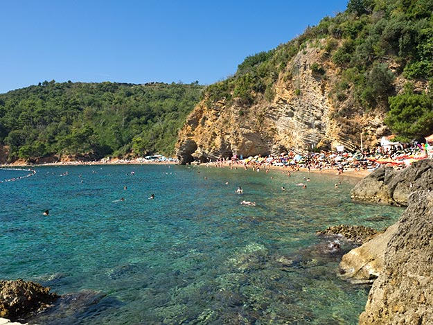 Crystal clear waters of Mogren Beaches. Unfortunately they were tiny and overcrowded, even off-season.