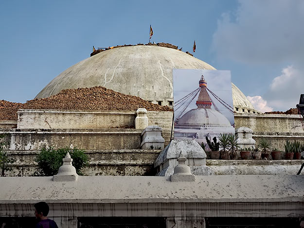 Photo in the foreround shows how the UNESCO World Heritage site of Boudhanath looked prior to the earthquake. The spire had to be taken down for repairs due to cracks at its base.