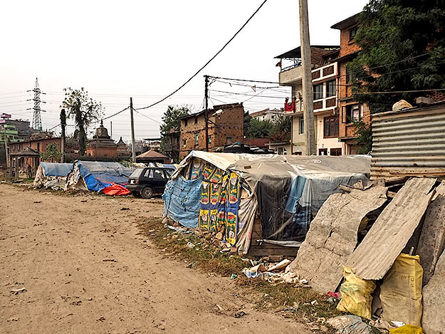 Thousands of people are still living in makeshift plastic and newspaper tents like these I was along the shores of the Bagmati River in Kathmandu