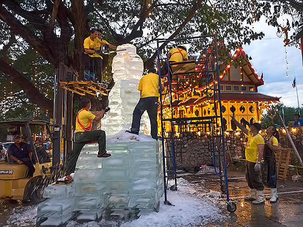 In Hua Hin, Thailand, a crew of world renowned ice sculptors carve what they claim is the tallest statue of Buddha ever made in ice, during the celebration of the King's 88th birthday