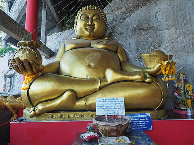 Buddha at the entrance to Khao Tao Temple, just south of Hua Hin. It is said that pitting a donation into the slot in his big belly ensures good luck.