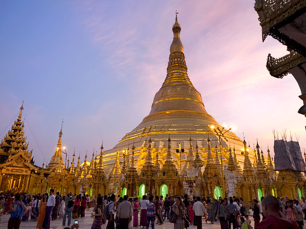 As the sun sets, Shwedagon Pagoda in Yangon, Myanmar begins to glow as if illuminated from within