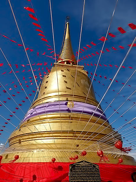 The stupa that crowns the roof of the Golden Mount temple