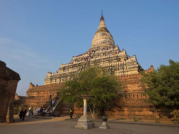 Crowds climb Shwesandaw Pagoda to watch the sun set over a plain dotted with scores of ancient temples