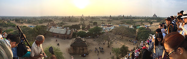 Panoramic view from the top of Shwesandaw Pagoda, with every inch of space occupied by tourists awaiting the sunset