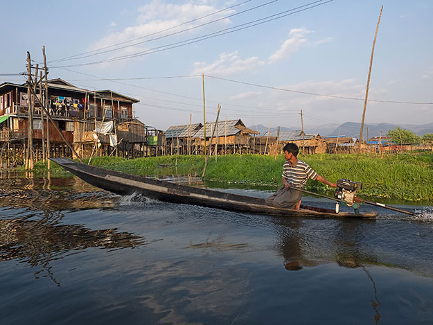 Flat-bottom boats like this one arethe main form of transport used by the Intha people who live on stilt-houses built above Inle Lake