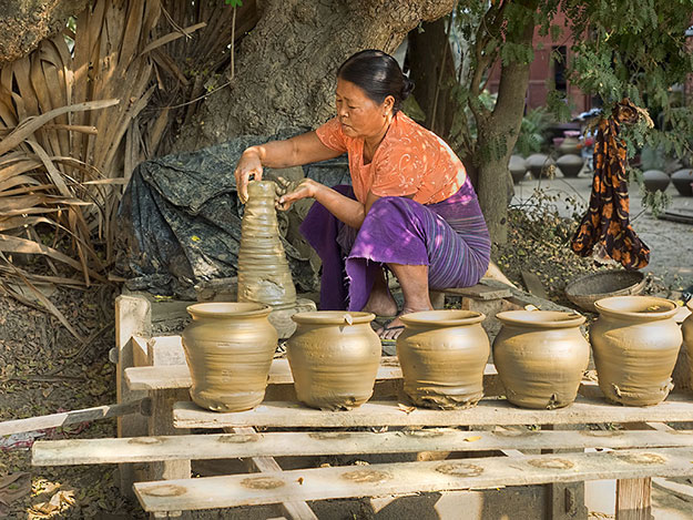Women in the pottery-making village of Yandabo make ceramic water pots used all over the country