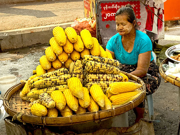 Vendor sells corn on the cob at Maha Bandoola Garden in Yangon, Myanmar