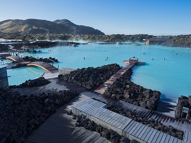 Thermal pools at the Blue Lagoon in Iceland. The water in the far pools is hotter and deeper.