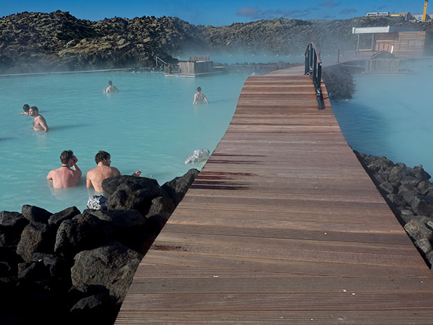 Steam rises from the water in parts of the Blue Lagoon that are hotter