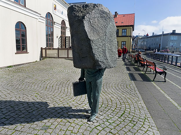 "Sculpture titled ""The Unknown Bureaucrat"" stands in front of Reykjavik's City Hall"