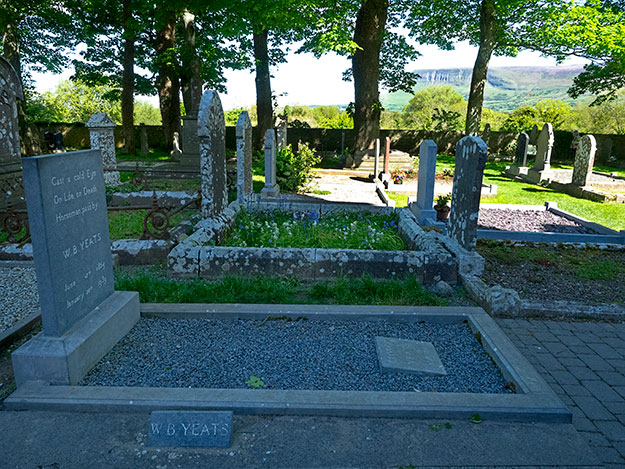 Paying my respects at the grave of the Nobel laureate poet, W.B. Yeats, in Sligo County, Ireland