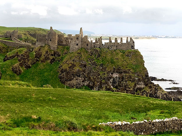 Ruins of Dunluce Castle on a rainy day on the Causeway Coast in Northern Ireland