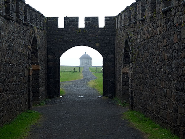Mussenden Temple, seen through the ruins of Downhill Demesne, is a lesser visited but stunning site on the Causeway Coast in Northern Ireland