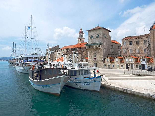 Boats moored along the Riva in the UNESCO World Heritage town of Trogir, Croatia