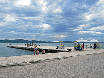 Catching some rays on the Riva in Zadar, Croatia