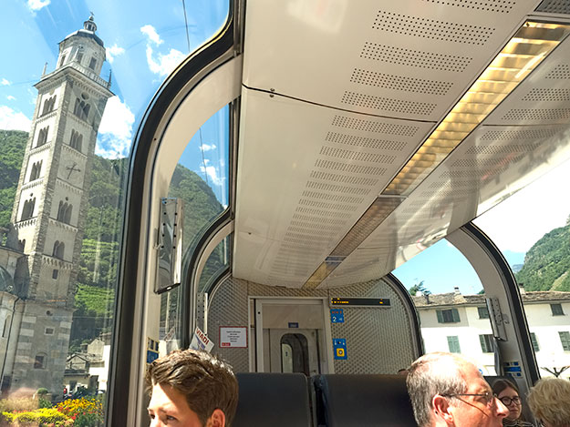 Sanctuary of the Madonna is seen through the panoramic window of the Bernina Express train as it passes down the main street of Tirano, Italy