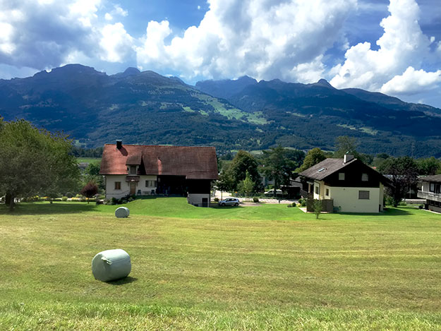 Idyllic countryside farms dot lush green valleys that are tucked between soaring mountains in Liechtenstein